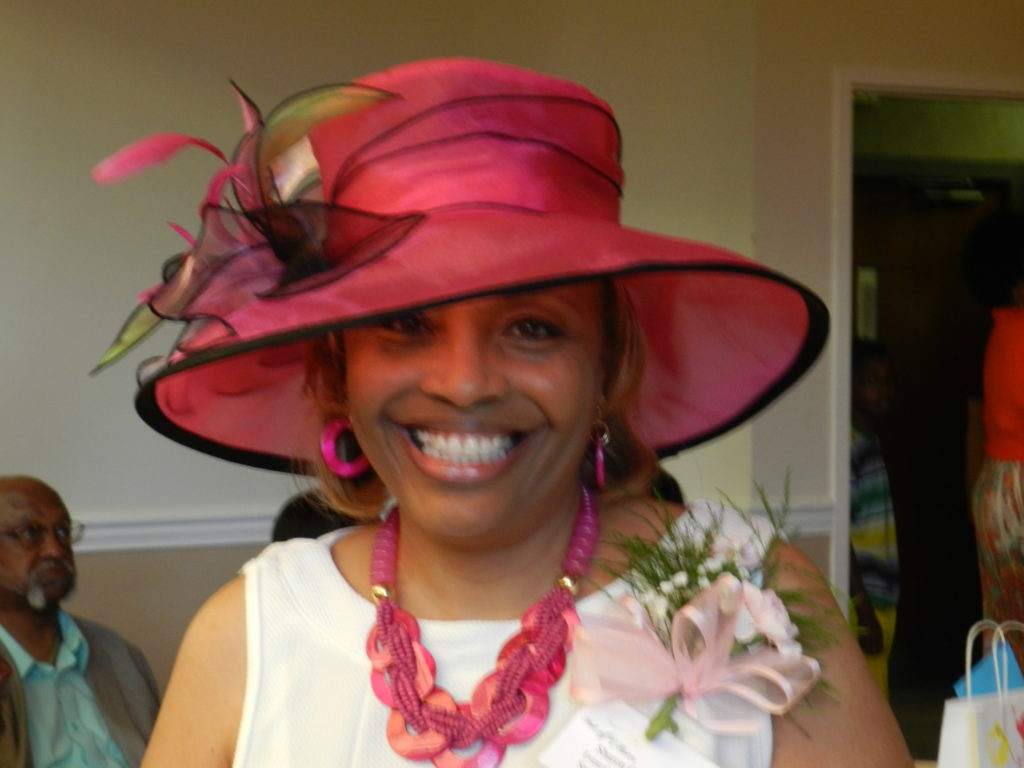 Sharon Gressem, 2015 Hats Off to Mom Chair with her stunning pink hat.
