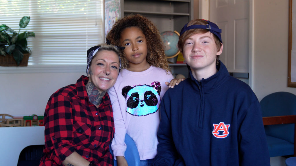 A mother and her two children, a mixed race family