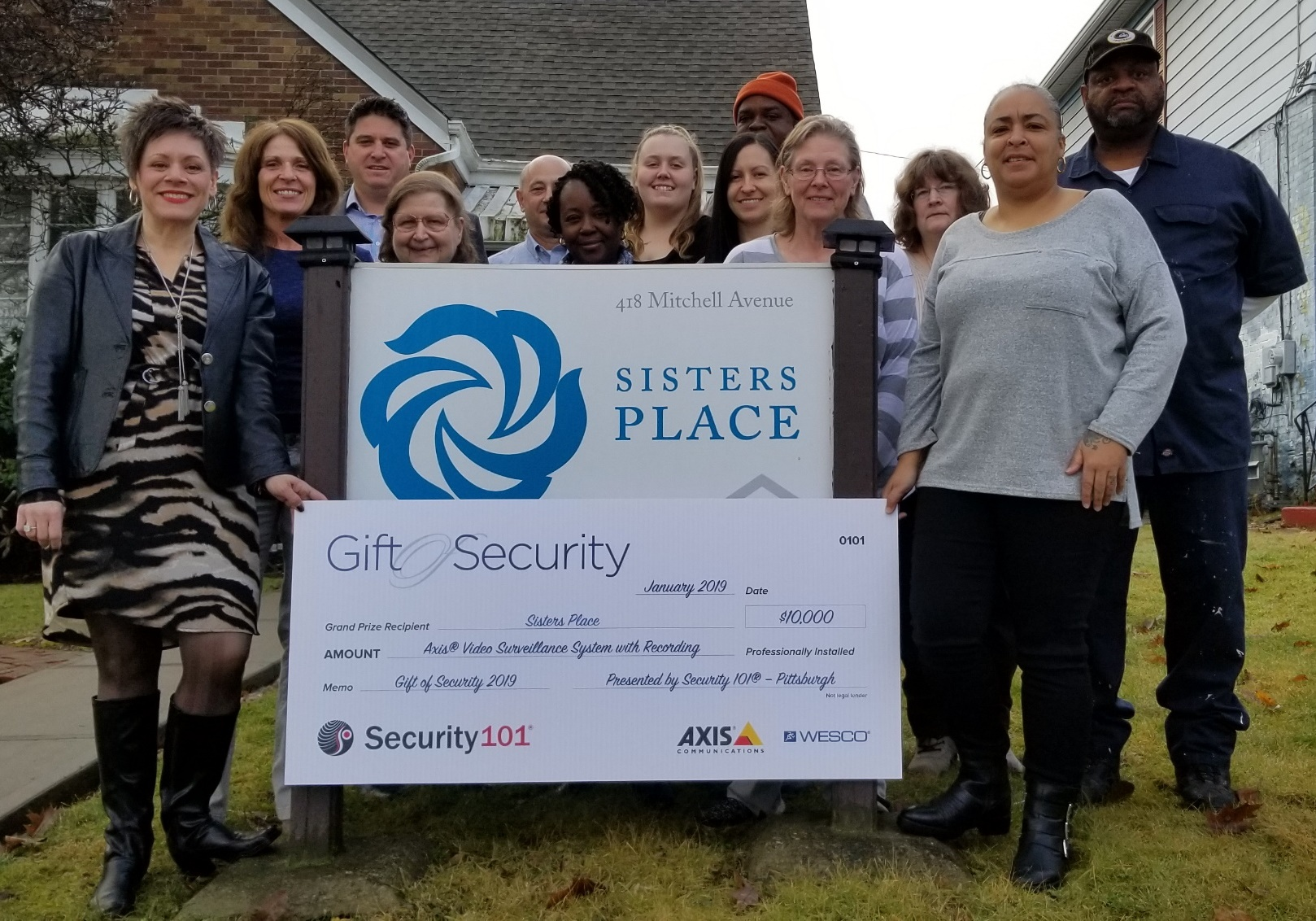 Sisters Place posting with a large check from Gift Security.
