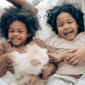 Two young black children smiling